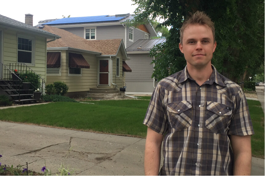 Matt Pointer, a member of Wascana Solar Cooperative, stands in front of his solar powered house on June 17, 2018.