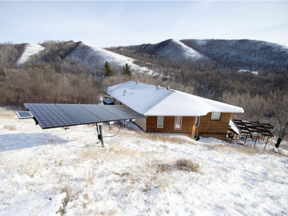 Jim Harding's house near Fort Qu'Appelle is powered by five solar panels and a 35-foot wind turbine. TROY FLEECE / Regina Leader-Post