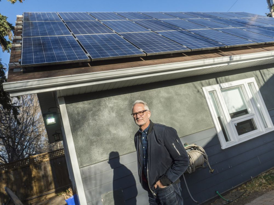 Stephen Hall stands in front of solar panels mounted to the roof his home studio. MICHAEL BELL/Regina Leader-Post